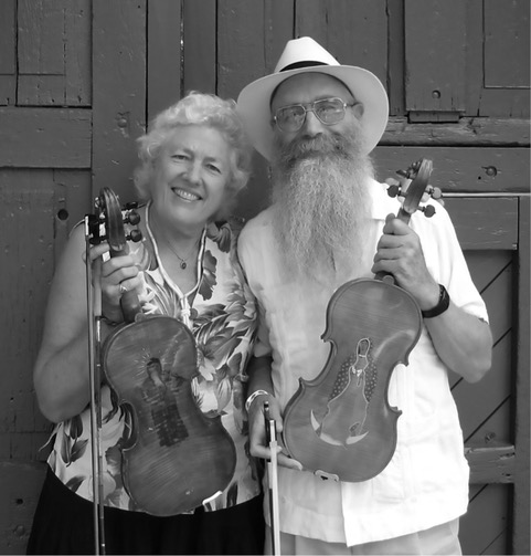 Ken Keppeler & Jeanine McLerie proudly displaying their engraved well used fiddles